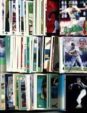 100 Assorted Oakland Athletics Baseball Cards Plus Twelve 9-Pocket Storage Pages (stores up to 216 cards)